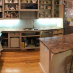 Before: phase 1, cabinet doors and backsplash removed, old granite still in place